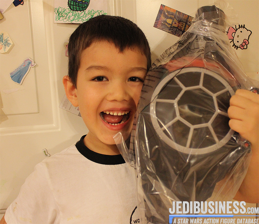 Evan holding the black series Tie Fighter